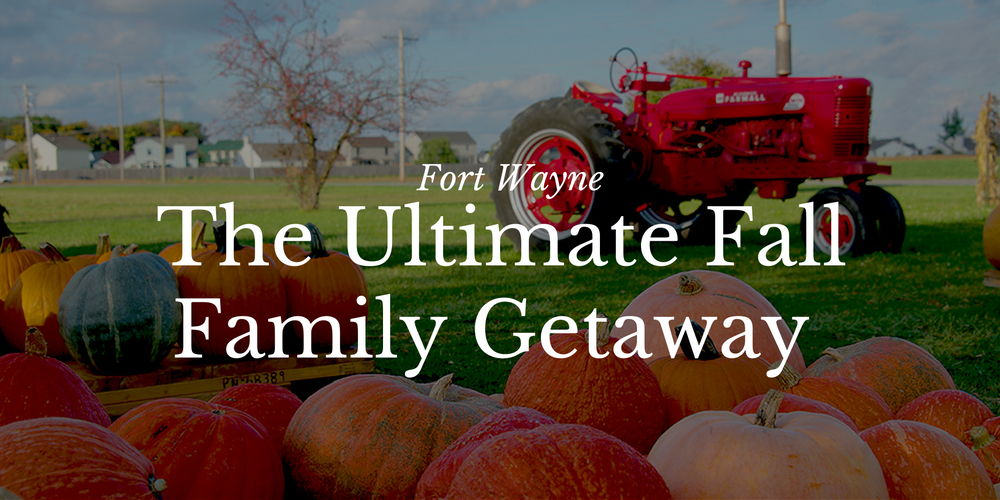 "Fall pumpkins in front of a red tractor with ""The Ultimate Fall Family Getaway"" text overlayed."